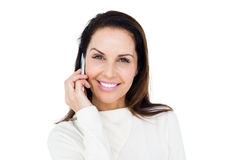 Cheerful brunette with her mobile phone calling someone Stock Image