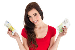 Cheerful brunette holding her cash money Stock Photography