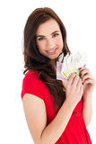 Cheerful brunette holding her cash Royalty Free Stock Photography