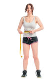 Cheerful brunette with a measuring tape Royalty Free Stock Images