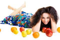 Cheerful brunette relaxing with fresh fruits Royalty Free Stock Photos