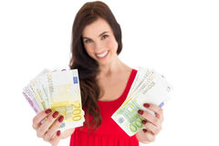 Cheerful brunette showing her cash money Stock Images