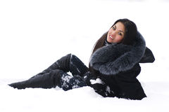 Cheerful brunette sitting on snow Royalty Free Stock Photo