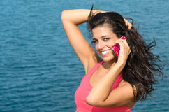 Cheerful brunette using phone in summer Royalty Free Stock Photo