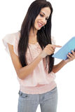 Cheerful brunette using tablet pc Stock Image
