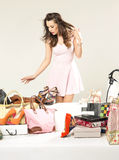 Cheerful brunette woman in the shoe shop Stock Image