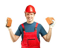Cheerful builder holding bricks royalty free stock photos