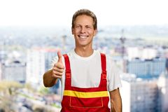 Cheerful builder showing thumb up. Royalty Free Stock Photo