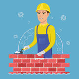 A cheerful builder in a yellow helmet puts a brick. Young man mason holding spatula in hand near wall. Colored vector illustration in flat style Stock Photos