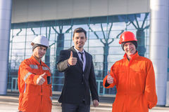 Cheerful builders with the manager Royalty Free Stock Image