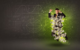 Cheerful businesman jumping with dollar banknotes around him Stock Photos