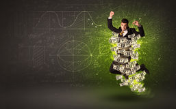 Cheerful businesman jumping with dollar banknotes around him Royalty Free Stock Images
