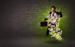 Cheerful businesman jumping with dollar banknotes around him Stock Images