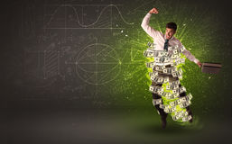 Cheerful businesman jumping with dollar banknotes around him Stock Image