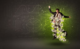 Cheerful businesman jumping with dollar banknotes around him Royalty Free Stock Image