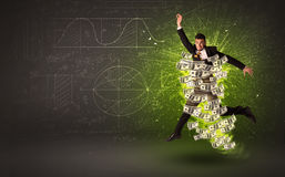 Cheerful businesman jumping with dollar banknotes around him Royalty Free Stock Photos