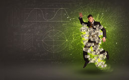 Cheerful businesman jumping with dollar banknotes around him Royalty Free Stock Photography