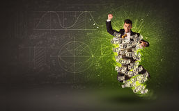 Cheerful businesman jumping with dollar banknotes around him Royalty Free Stock Photo