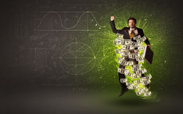 Cheerful businesman jumping with dollar banknotes around him Stock Photography