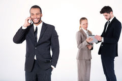 Cheerful business conversation. Successful and smiling African b Stock Photos