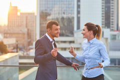 Cheerful business couple with tablet. Young men and women smiling. How to inspire staff Royalty Free Stock Image