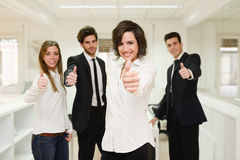 Cheerful business group giving thumbs up Stock Images
