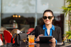 Cheerful business lady with tablet Royalty Free Stock Images