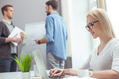 Cheerful business lady is working with team royalty free stock image