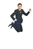 Cheerful business man jumping Royalty Free Stock Images