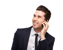 Cheerful business man talking on mobile phone Stock Photography