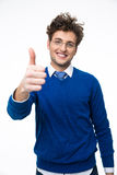 Cheerful business man with thumb up Stock Photo