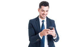 Cheerful business man using cellphone for sending a message Royalty Free Stock Photos