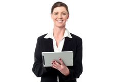 Cheerful business manager holding touch pad. Happy businesswoman holding touch pad over white Stock Images