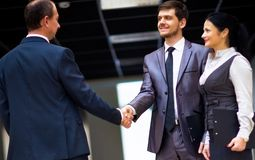 Cheerful business men shaking hands Royalty Free Stock Photo