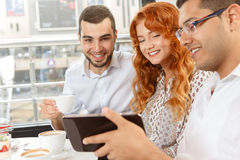 Cheerful business partners on coffee break. In cafe Royalty Free Stock Image