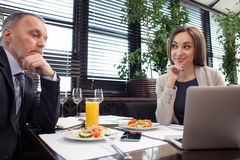 Cheerful business partners are discussing project in cafe Stock Images