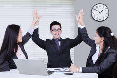 Cheerful business partners raising arms up Stock Images