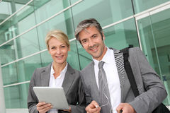 Cheerful business partners using tablet Royalty Free Stock Photos