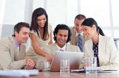 Cheerful business partners working at a computer Royalty Free Stock Image