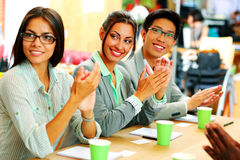 Cheerful business people applauding. In a meeting. Business concept Royalty Free Stock Photos