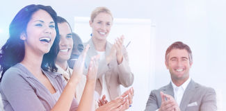 Cheerful business people applauding in a meeting. Business concept Stock Photos