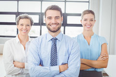 Cheerful business people with arms crossed Royalty Free Stock Photography