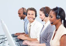 Cheerful business people with headset on Stock Photo