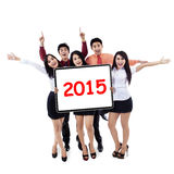 Cheerful business people hold number 2015 Stock Image
