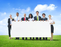 Cheerful Business People Holding Empty Billboard Outdoors royalty free stock photo