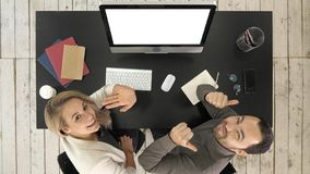 Cheerful business people looking to camera and talking in office. White Display. royalty free stock images