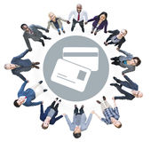 Cheerful Business People Looking Up with Credit Card Symbol Stock Photos