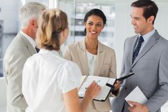 Cheerful business people making an appointment Stock Image