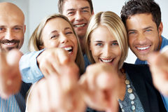 Cheerful business people pointing Royalty Free Stock Photo