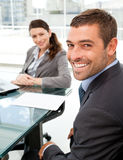 Cheerful business people sitting at a table Stock Photography